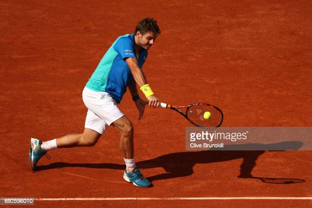 Stan Wawrinka of Switzerland plays a backhand during the men's singles fourth round match against Gael Monfils of France on day nine of the 2017...