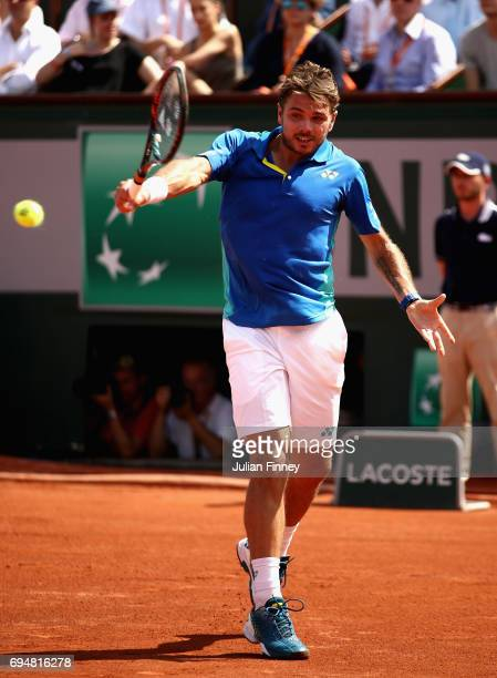 Stan Wawrinka of Switzerland plays a backhand during the mens singles final match against Rafael Nadal of Spain on day fifteen of the 2017 French...
