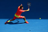 Stan Wawrinka of Switzerland plays a backhand in his fourth round match against Milos Raonic of Canada during day eight of the 2016 Australian Open...
