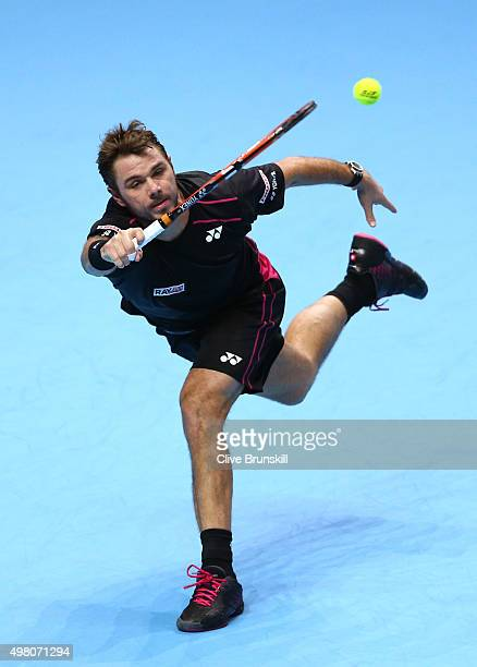 Stan Wawrinka of Switzerland plays a forehand during the men's singles match against Andy Murray of Great Britain on day six of the Barclays ATP...