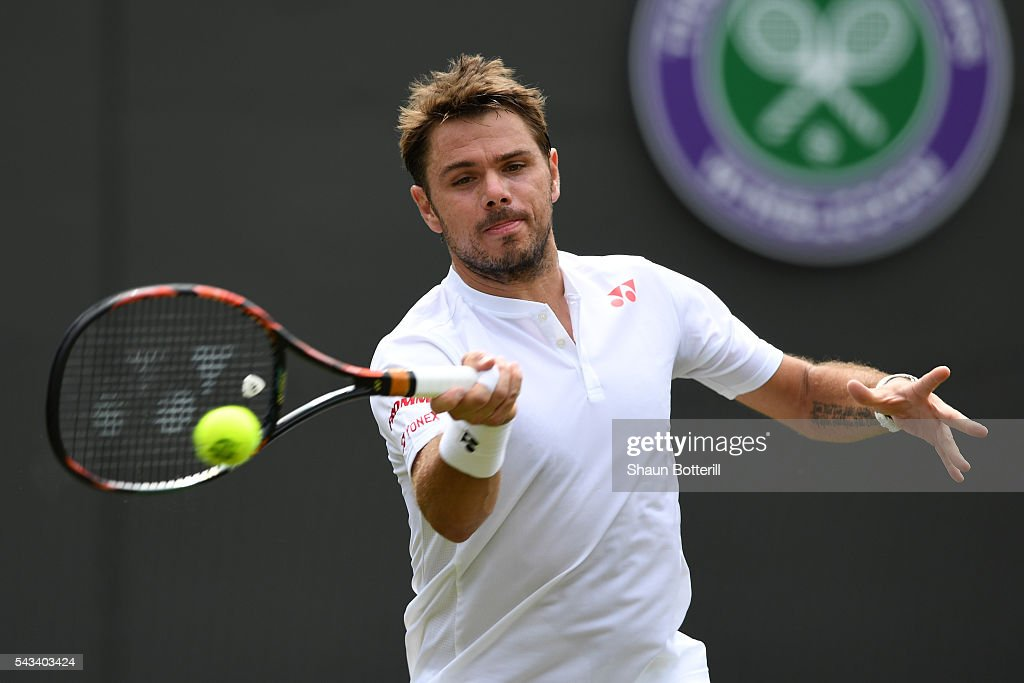 Stan Wawrinka of Switzerland plays a forehand during the Men's Singles first round match against Taylor Fritz of The United States on day two of the Wimbledon Lawn Tennis Championships at the All England Lawn Tennis and Croquet Club on June 28, 2016 in London, England.
