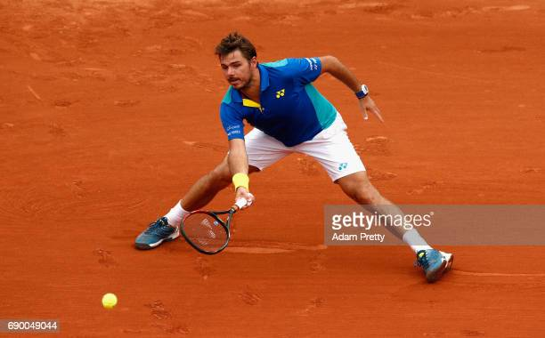 Stan Wawrinka of Switzerland plays a forehand during the mens singles first round match against Josef Kovalik of Slovakia on day three of the 2017...