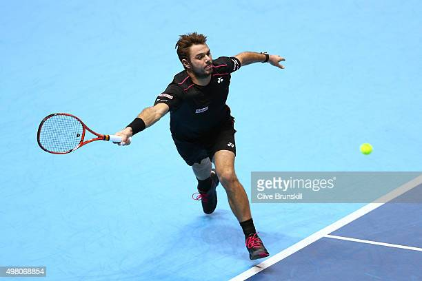Stan Wawrinka of Switzerland plays a forehand the men's singles match against Andy Murray of Great Britain on day six of the Barclays ATP World Tour...