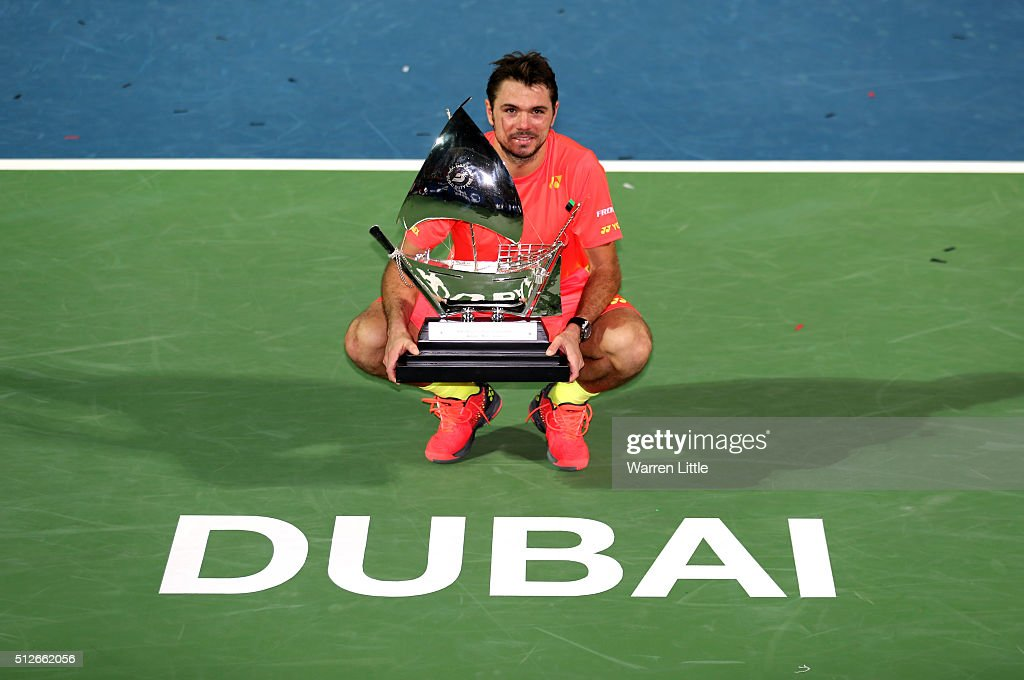 Stan Wawrinka of Switzerland poses with the trophy after beating Marcos Baghdatis of Cyrus to win the ATP Dubai Duty Free Tennis Championship at the...