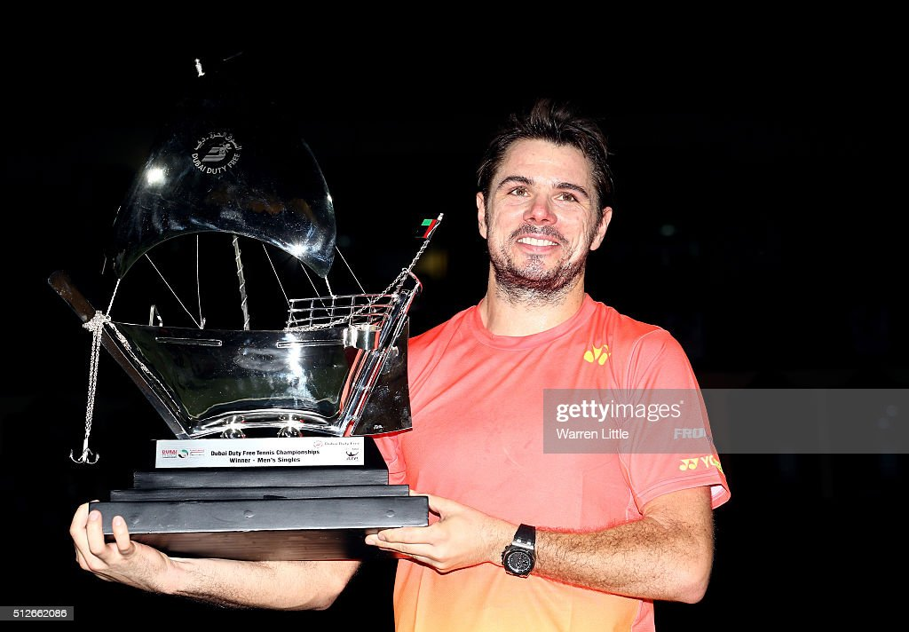 Stan Wawrinka of Switzerland poses with the trophy after beating Marcos Baghdatis of Cyrus to win the ATP Dubai Duty Free Tennis Championship at the Dubai Duty Free Stadium on February on February 27, 2016 in Dubai, United Arab Emirates.