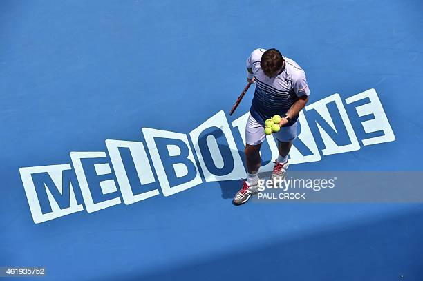 Stan Wawrinka of Switzerland prepares to serve against Marius Copil of Romania in their men's singles match on day four of the 2015 Australian Open...