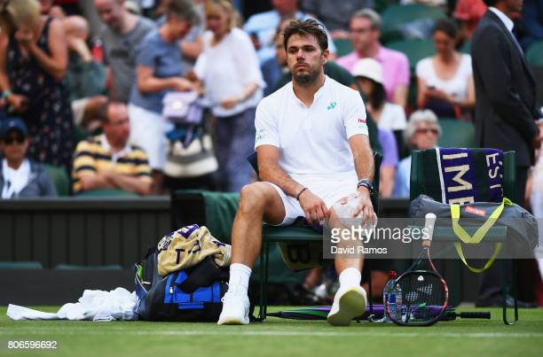 Stan Wawrinka of Switzerland puts ice on his knee during the Gentlemen's Singles first round match against Daniil Medvedev of Russia on day one of...