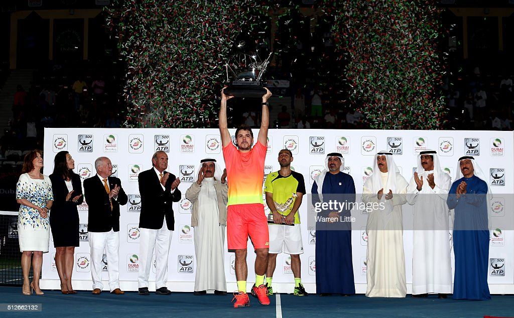 Stan Wawrinka of Switzerland raises the trophy after beating <a gi-track='captionPersonalityLinkClicked' href=/galleries/search?phrase=Marcos+Baghdatis&family=editorial&specificpeople=226943 ng-click='$event.stopPropagation()'>Marcos Baghdatis</a> of Cyrus to win the ATP Dubai Duty Free Tennis Championship at the Dubai Duty Free Stadium on February on February 27, 2016 in Dubai, United Arab Emirates.