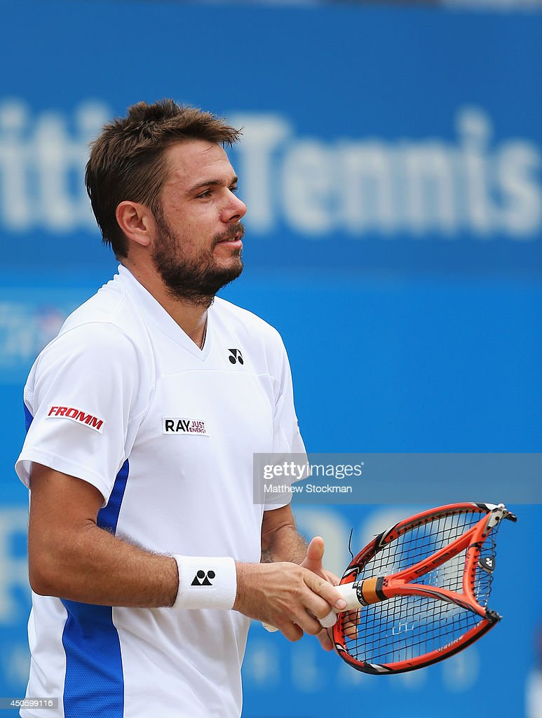 Stan Wawrinka of Switzerland reacts after damaging his racquet in his match against Grigor Dimitrov of Bulgaria during their Men's Singles semi-final on day six of the Aegon Championships at Queens Club on June 14, 2014 in London, England.