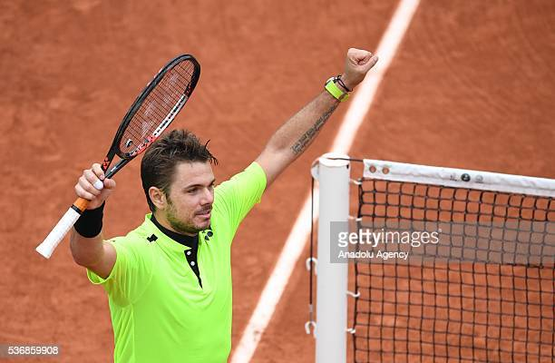 Stan Wawrinka of Switzerland reacts after winning his men's single quarter final match against Albert RamosVinolas of Spain at the French Open tennis...