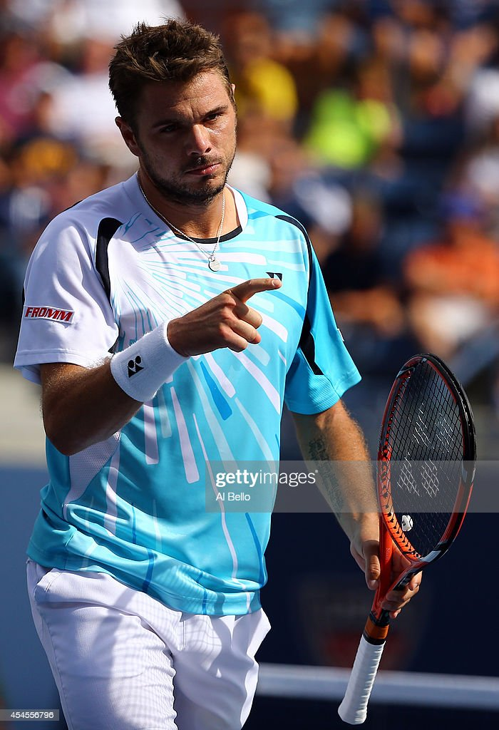 Stan Wawrinka of Switzerland reacts against Kei Nishikori of Japan during their men's singles quarterfinal match on Day Ten of the 2014 US Open at the USTA Billie Jean King National Tennis Center on September 3, 2014 in the Flushing neighborhood of the Queens borough of New York City.