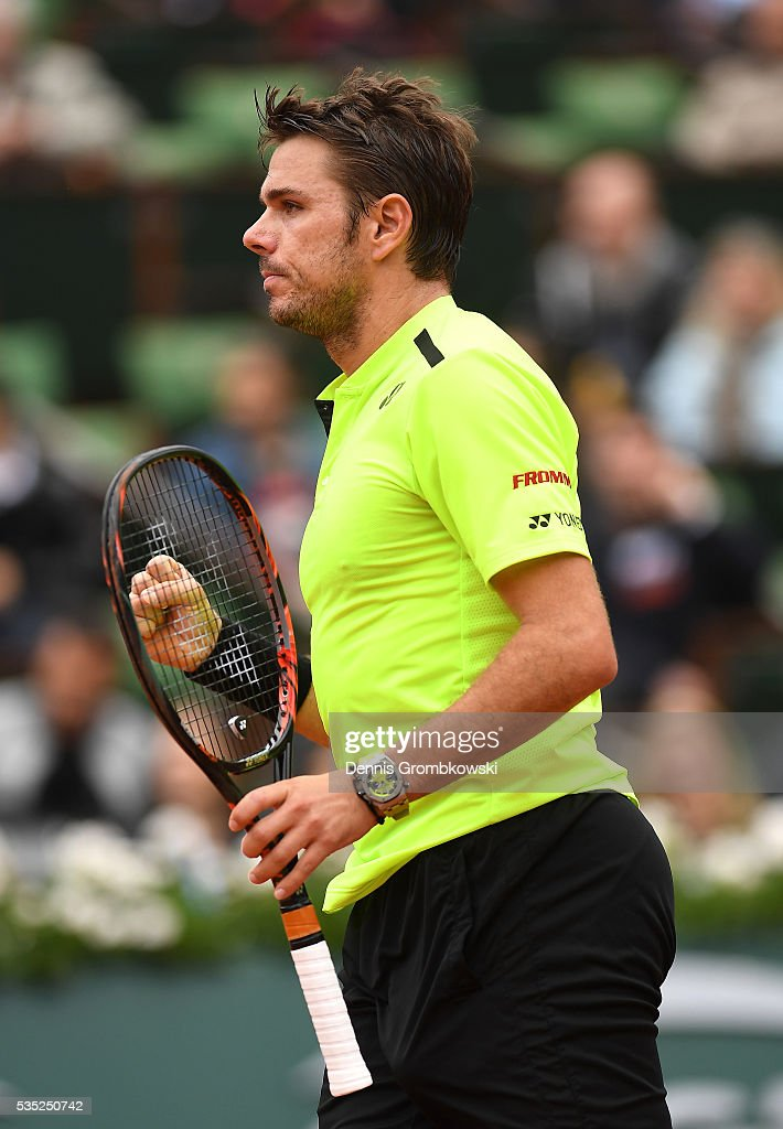 Stan Wawrinka of Switzerland reacts during the Men's Singles fourth round match against Viktor Troicki of Serbia on day eight of the 2016 French Open at Roland Garros on May 29, 2016 in Paris, France.