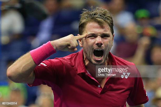 Stan Wawrinka of Switzerland reacts to winning the second set against Kei Nishikori of Japan during their Men's Singles Semifinal Match on Day Twelve...