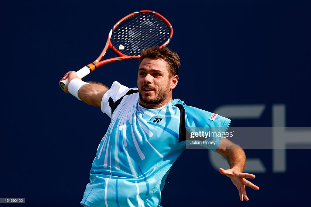Stan Wawrinka of Switzerland returns a shot against Kei Nishikori of Japan during their men's singles quarterfinal match on Day Ten of the 2014 US Open at the USTA Billie Jean King National Tennis Center on September 3, 2014 in the Flushing neighborhood of the Queens borough of New York City.