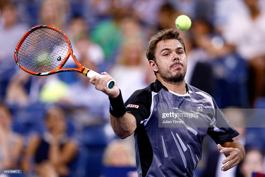 Stan Wawrinka of Switzerland returns a shot against Thomaz Bellucci of Brazil during their men's singles second round match on Day Three of the 2014...