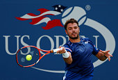 Stan Wawrinka of Switzerland returns a shot to Donald Young of the United States during their Men's Singles Fourth Round match on Day Eight of the...