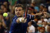 Stan Wawrinka of Switzerland returns a shot to Kevin Anderson of South Africa during their Men's Singles Quarterfinals match on Day Ten of the 2015...