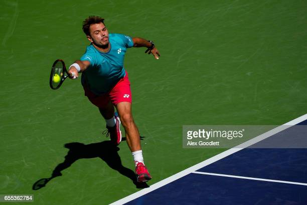 Stan Wawrinka of Switzerland returns a shot to Roger Federer of Switzerland in the men's final on day 14 during the BNP Paribas Open at Indian Wells...