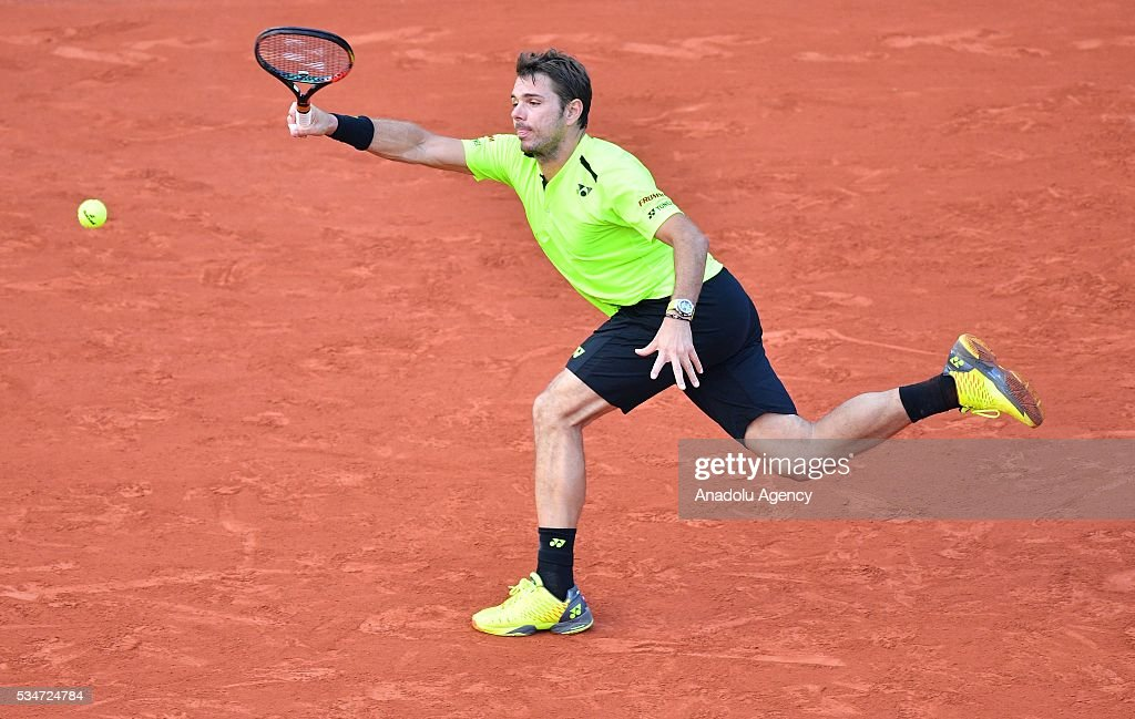 Stan Wawrinka of Switzerland returns to Jeremy Chardy (not seen) of France during the men's single third round match at the French Open tennis tournament at Roland Garros Stadium in Paris, France on May 27, 2016.