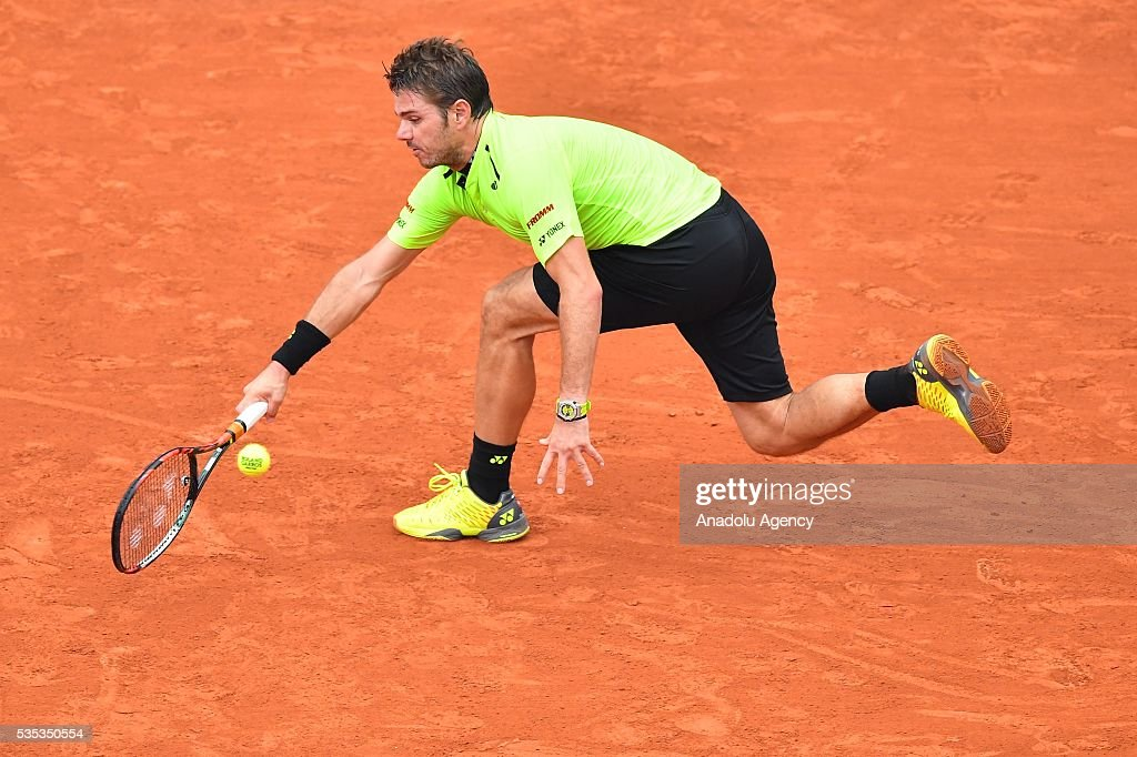 Stan Wawrinka of Switzerland returns to Viktor Troicki of Serbia during the men's single fourth round match at the French Open tennis tournament at Roland Garros Stadium in Paris, France on May 29, 2016.