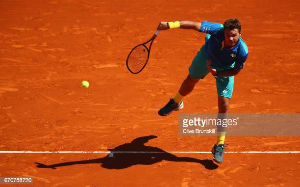 Stan Wawrinka of Switzerland serves against Pablo Cuevas of Uruguay in his third round match on day five of the Monte Carlo Rolex Masters at...