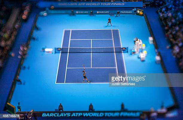 Stan Wawrinka of Switzerland serves during his match against Tomas Berdych of Czech Republic in the round robin during day two of the Barclays ATP...
