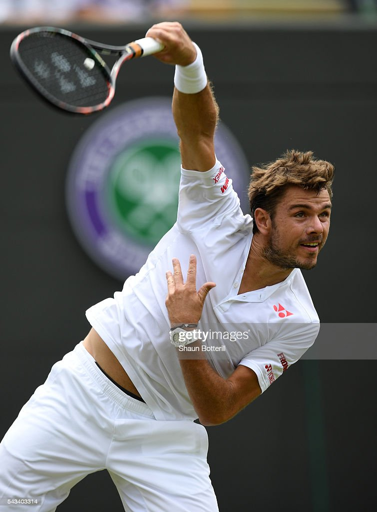 Stan Wawrinka of Switzerland serves during the Men's Singles first round match against Taylor Fritz of The United States on day two of the Wimbledon Lawn Tennis Championships at the All England Lawn Tennis and Croquet Club on June 28, 2016 in London, England.