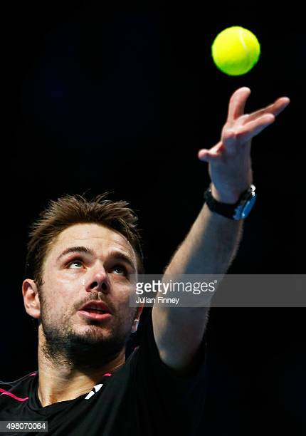 Stan Wawrinka of Switzerland serves during the men's singles match against Andy Murray of Great Britain on day six of the Barclays ATP World Tour...