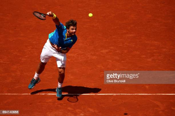 Stan Wawrinka of Switzerland serves during the men's singles semi final match against Andy Murray of Great Britain on day thirteen of the 2017 French...
