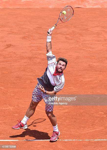 Stan Wawrinka of Switzerland serves the ball to JoWilfried Tsonga of France during their men's singles semifinal match at the French Open tennis...