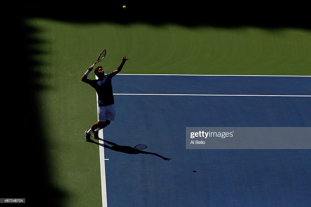 Stan Wawrinka of Switzerland serves to Donald Young of the United States during their Men's Singles Fourth Round match on Day Eight of the 2015 US Open at the USTA Billie Jean King National Tennis Center on September 7, 2015 in the Flushing neighborhood of the Queens borough of New York City.