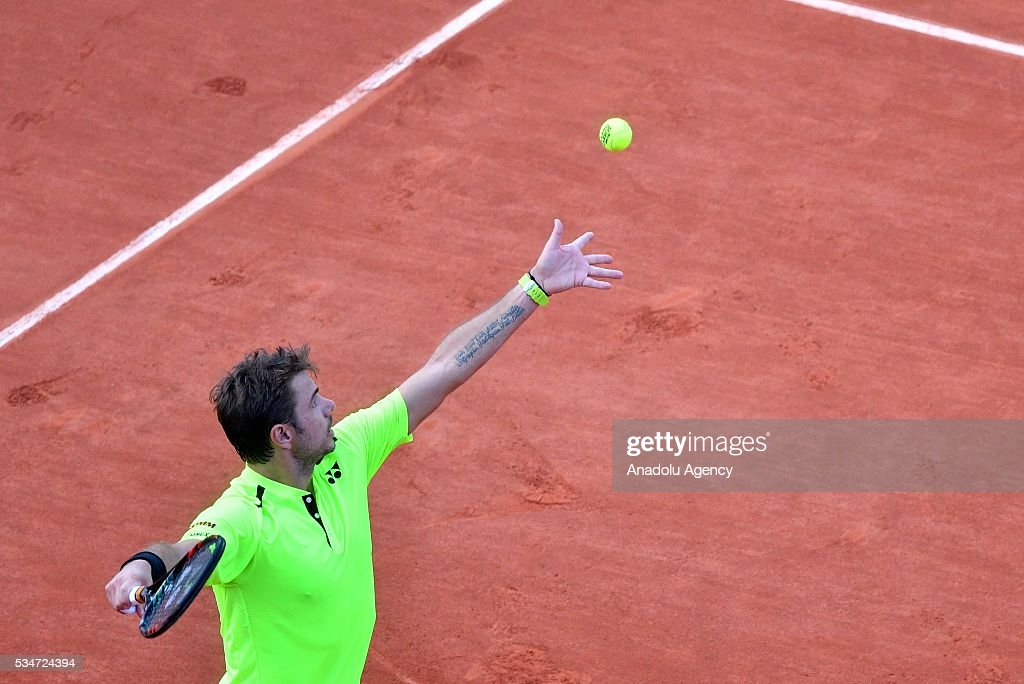Stan Wawrinka of Switzerland serves to Jeremy Chardy (not seen) of France during the men's single third round match at the French Open tennis tournament at Roland Garros Stadium in Paris, France on May 27, 2016.