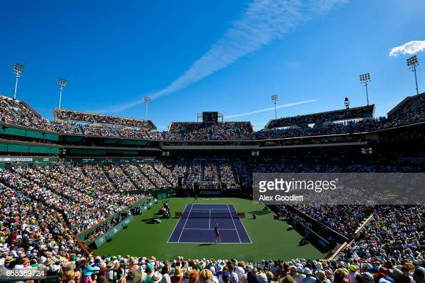 Stan Wawrinka of Switzerland serves to Roger Federer of Switzerland in the men's final on day 14 during the BNP Paribas Open at Indian Wells Tennis...