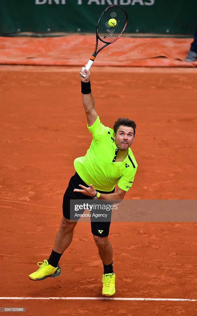 Stan Wawrinka of Switzerland serves to Taro Daniel of Japan (not seen) during their men's single 2nd round match at the French Open tennis tournament at Roland Garros in Paris, France on May 25, 2016.