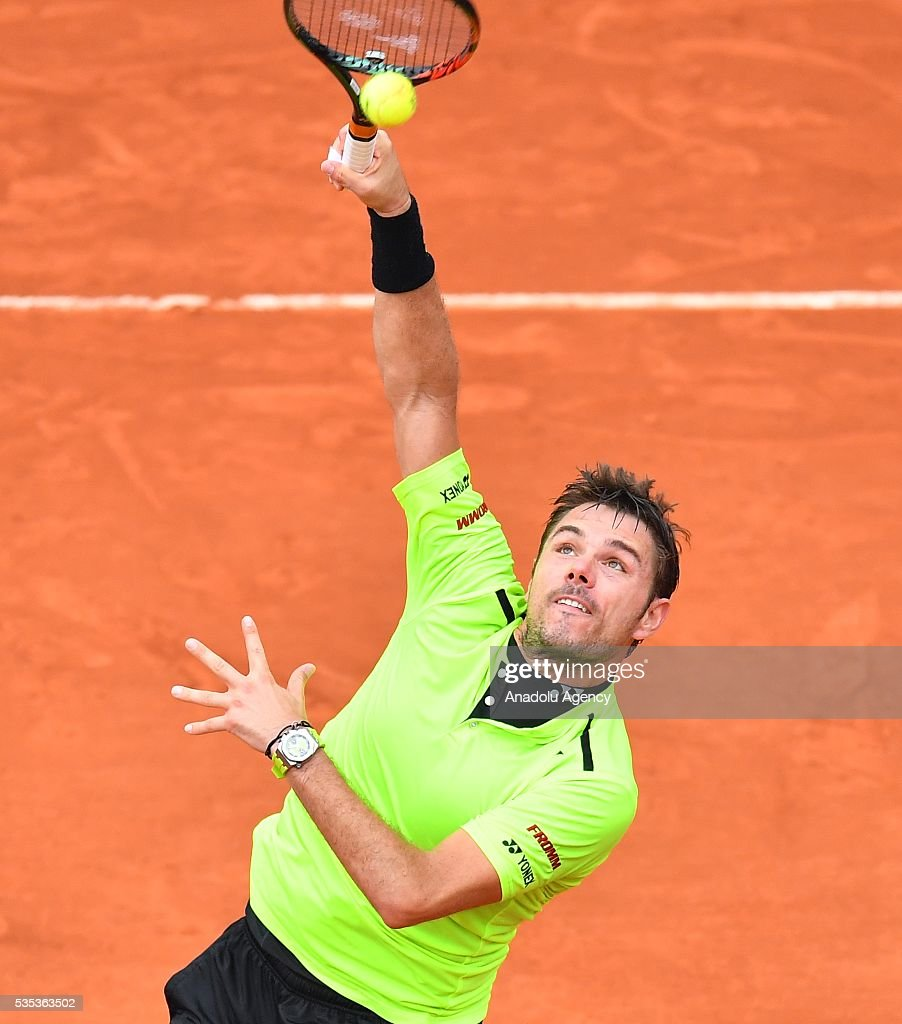 Stan Wawrinka of Switzerland serves to Viktor Troicki of Serbia during the men's single fourth round match at the French Open tennis tournament at Roland Garros Stadium in Paris, France on May 29, 2016.