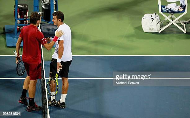 Stan Wawrinka of Switzerland shakes hands with Alessandro Giannessi after their second round Men's Singles match on Day Four of the 2016 US Open at...