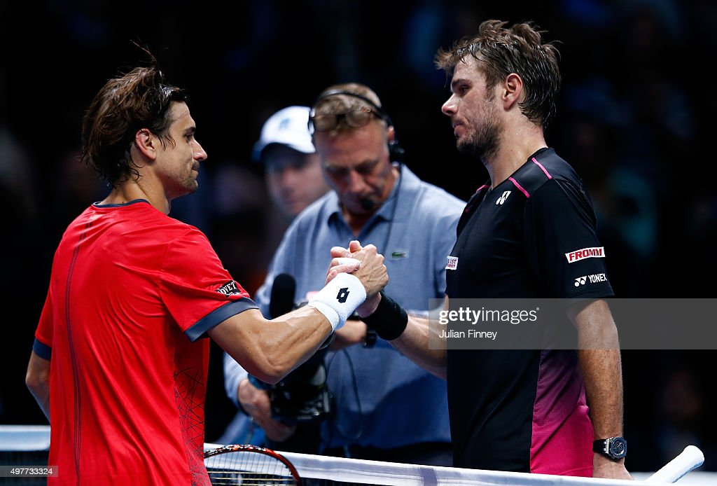 Stan Wawrinka of Switzerland (R) shakes hands with David Ferrer of Spain (L) after his victory in their men's singles match during day four of the Barclays ATP World Tour Finals at the O2 Arena on November 18, 2015 in London, England.