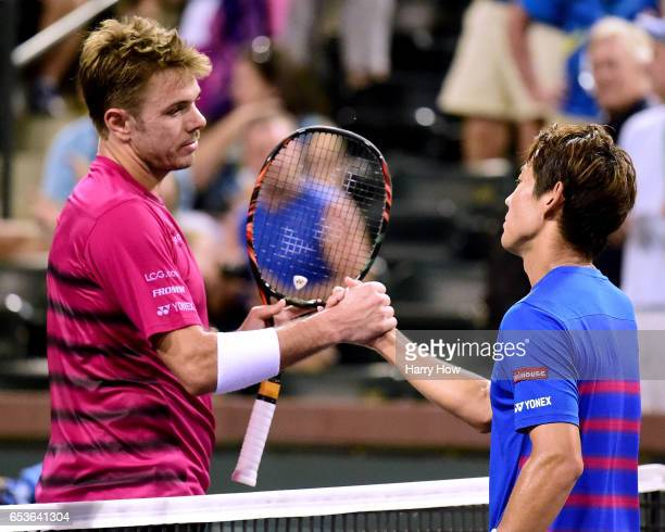 Stan Wawrinka of Switzerland shakes hands with Yoshihito Nishioka of Japan after beating him during the BNP Paribas at Indian Wells Tennis Garden on...