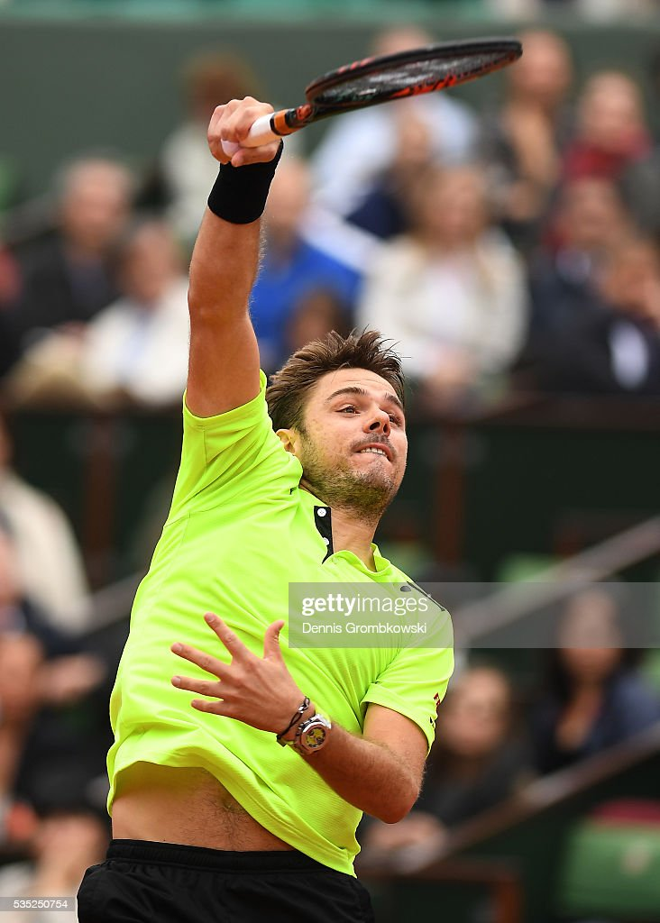 Stan Wawrinka of Switzerland smashes during the Men's Singles fourth round match against Viktor Troicki of Serbia on day eight of the 2016 French Open at Roland Garros on May 29, 2016 in Paris, France.