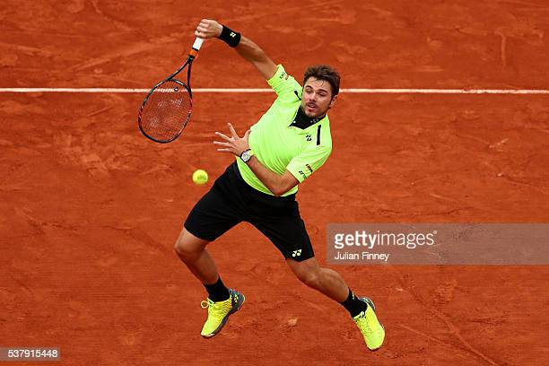 Stan Wawrinka of Switzerland smashes during the Men's Singles semi final match against Andy Murray of Great Britain on day thirteen of the 2016...