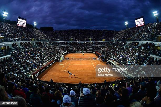 Stan Wawrinka of Switzerland stretches for a backhand under the Rome lights during his Men's Semi Final against compatriot Roger Federer on Day Seven...