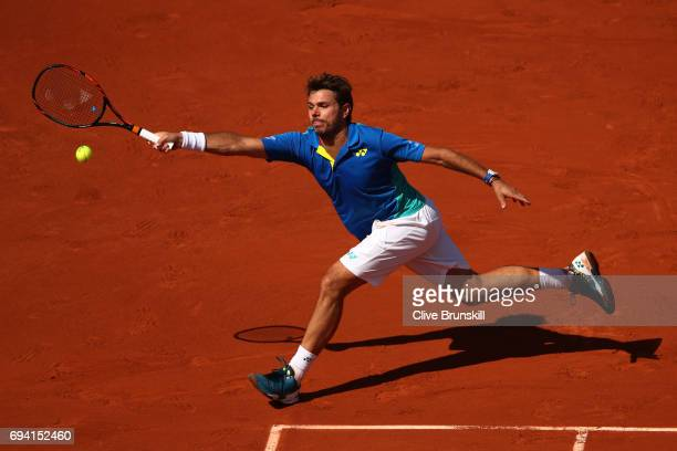 Stan Wawrinka of Switzerland stretches to hit a forehand during the men's singles semi final match against Andy Murray of Great Britain on day...