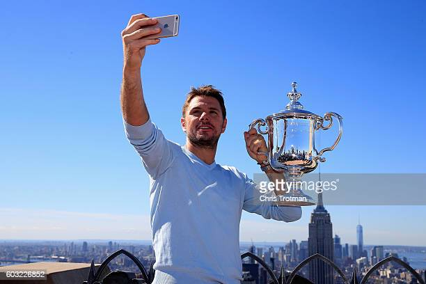 Stan Wawrinka of Switzerland the 2016 US Open Men's Singles champion poses for a selfie with the winners trophy at the Top of the Rock Observation...