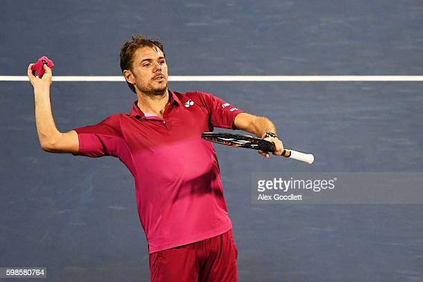 Stan Wawrinka of Switzerland throws a wrist band to the fans after defeating Alessandro Giannessi of Italy during his second round Men's Singles...