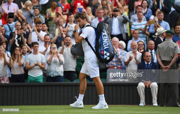 Stan Wawrinka of Switzerland walks off dejected after losing the Gentlemen's Singles first round match against Daniil Medvedev of Russia on day one...