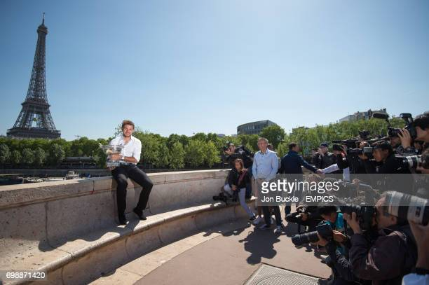 Stan Wawrinka poses with the Men's singles Trophy at Pont de Bir Hakeim with Eiffel Tower in the back ground the day after The 2015 French Open Final