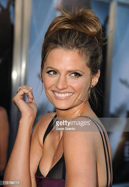 Stana Katic arrives at the 'Elysium' Los Angeles Premiere at Regency Village Theatre on August 7 2013 in Westwood California