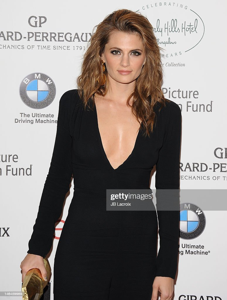 <a gi-track='captionPersonalityLinkClicked' href=/galleries/search?phrase=Stana+Katic&family=editorial&specificpeople=2081035 ng-click='$event.stopPropagation()'>Stana Katic</a> attends the 100th anniversary celebration of the Beverly Hills Hotel & Bungalows supporting the Motion Picture & Television Fund and the American Comedy Fund hosted by Brett Ratner and Warren Beatty at The Beverly Hills Hotel on June 16, 2012 in Beverly Hills, California.