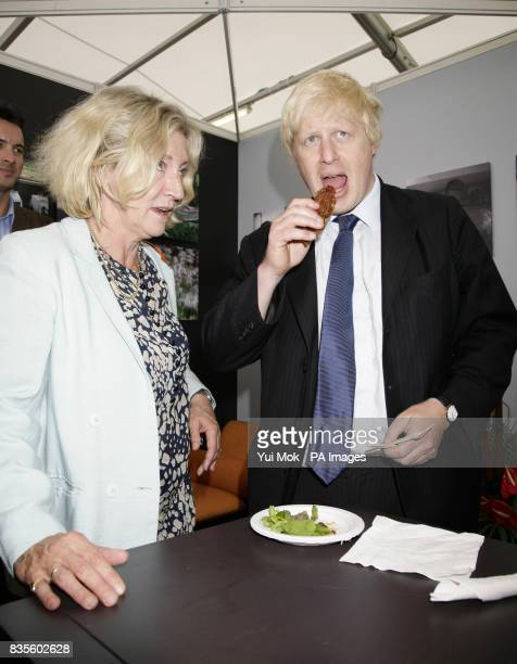 Stand alone photo Mayor of London Boris Johnson and Rosie Boycott sampling some food from Giorgio Locatelli's food stall during the Taste of London...