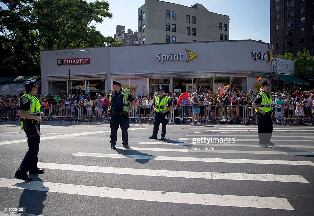 NYPD stand as people march during the New York City Pride March, June 26, 2016 in New York City. This year was the 46th Pride march in New York City